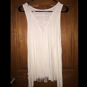 White loose with a low cut neck line
